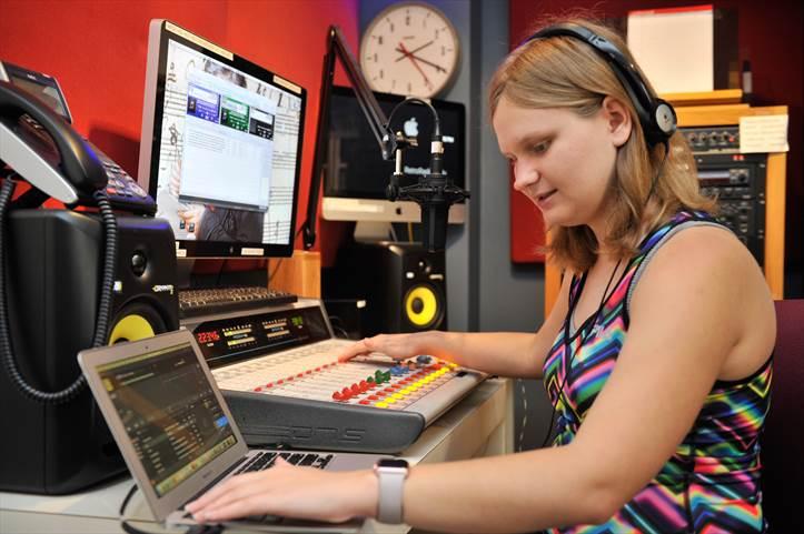 Blind student DJ at the soundboard.